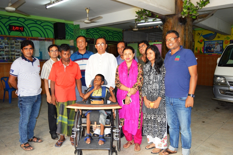 HEED Bangladesh donated this custom made special chair to Autistic and handicapped child Mobarok Hossain